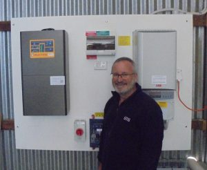 Paul Gilders with the battery and solar inverters